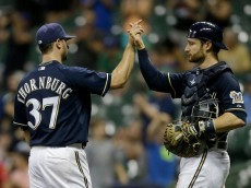 MILWAUKEE, WI - SEPTEMBER 02: Tyler Thornburg #37 of the Milwaukee Brewers celebrates with Jonathan Lucroy #20 after the 9-4 win over the Pittsburgh Pirates at Miller Park on September 02, 2015 in Milwaukee, Wisconsin. (Photo by Mike McGinnis/Getty Images)  *** Local Caption *** Tyler Thornburg; Jonathan Lucroy