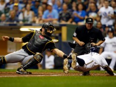 MILWAUKEE, WI - SEPTEMBER 03: Francisco Cervelli #29 of the Pittsburgh Pirates tags out Elian Herrera #3 of the Milwaukee Brewers during the sixth inning at Miller Park on September 3, 2015 in Milwaukee, Wisconsin.  (Photo by Jeff Haynes/Getty Images)
