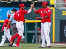 CINCINNATI, OH - SEPTEMBER 07: Eugenio Suarez #7  and Jumbo Diaz #70 of the Cincinnati Reds celebrate after the conclusion of the eighth inning against the Pittsburgh Pirates at Great American Ball Park on September 7, 2015 in Cincinnati, Ohio. Cincinnati defeated Pittsburgh 3-1. (Photo by Michael Hickey/Getty Images)