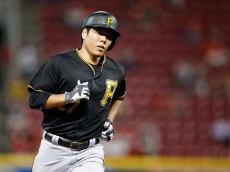 CINCINNATI, OH - SEPTEMBER 9: Jung Ho Kang #27 of the Pittsburgh Pirates rounds the bases after hitting a grand slam home run in the sixth inning against the Cincinnati Reds at Great American Ball Park on September 9, 2015 in Cincinnati, Ohio. (Photo by Joe Robbins/Getty Images)