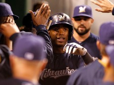 PITTSBURGH, PA - SEPTEM BER 10:  Jean Segura #9 of the Milwaukee Brewers celebrates with teammates after scoring on a RBI single in the thirteenth inning during the game against the Pittsburgh Pirates at PNC Park on September 10, 2015 in Pittsburgh, Pennsylvania.  (Photo by Justin K. Aller/Getty Images)