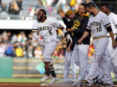 PITTSBURGH, PA - SEPTEM BER 13:  Josh Harrison #5 of the Pittsburgh Pirates celebrates with teammates after hitting a walk off single in the eleventh inning during the game against the Milwaukee Brewers at PNC Park on September 13, 2015 in Pittsburgh, Pennsylvania.  (Photo by Justin K. Aller/Getty Images)