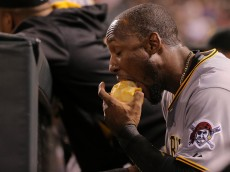 DENVER, CO - SEPTEMBER 21:  Starling Marte #6 of the Pittsburgh Pirates takes a bite of an apple on the dugout bench as the Pirates defeated the Colorado Rockies 9-3 at Coors Field on September 21, 2015 in Denver, Colorado.  (Photo by Doug Pensinger/Getty Images)