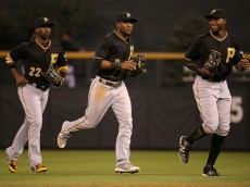 DENVER, CO - SEPTEMBER 22:  Outfielders Andrew McCutchen #22, Starling Marte #6 and Gregory Polanco #25 of the Pittsburgh Pirates celebrate their victory over the Colorado Rockies at Coors Field on September 22, 2015 in Denver, Colorado. The Pirates defeated the Rockies 6-3.  (Photo by Doug Pensinger/Getty Images)