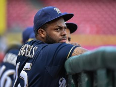 CINCINNATI, OH - SEPTEMBER 5:  Jason Rogers #15 of the Milwaukee Brewers takes a breather in the dugout against the Cincinnati Reds at Great American Ball Park on September 5, 2015 in Cincinnati, Ohio.  (Photo by Jamie Sabau/Getty Images)