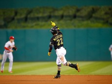 PITTSBURGH, PA - JULY 11: Andrew McCutchen #22 of the Pittsburgh Pirates reacts after hitting the game-winning two run home run in the 14th inning against the St Louis Cardinals during the game at PNC Park on July 11, 2015 in Pittsburgh, Pennsylvania.  (Photo by Jared Wickerham/Getty Images)
