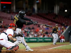 CINCINNATI, OHIO - APRIL 08: Starling Marte #6 of the Pittsburgh Pirates hits a grand slam in the eighth inning of the game against the Cincinnati Reds at Great American Ball Park on April 8, 2016 in Cincinnati, Ohio. The Pirates defeated the Reds 6-5. (Photo by Joe Robbins/Getty Images)