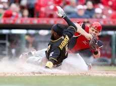 CINCINNATI, OH - APRIL 10: Devin Mesoraco #39 of the Cincinnati Reds tags out Josh Harrison #5 of the Pittsburgh Pirates at home plate to end the eight inning at Great American Ball Park on April 10, 2016 in Cincinnati, Ohio. Cincinnati defeated Pittsburgh 2-1. (Photo by Kirk Irwin/Getty Images)