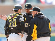 DETROIT, MI - APRIL 12: Pitching coach Ray Searage #54 talks with pitcher Juan Nicasio #12 and Francisco Cervelli #29 during the second inning of the interleague game against the Detroit Tigers on April 12, 2016 at Comerica Park in Detroit, Michigan. (Photo by Leon Halip/Getty Images)