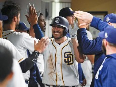 SAN DIEGO, CALIFORNIA - APRIL 19:  Adam Rosales #9 of the San Diego Padres, center, is congratulated in the dugout after hitting a solo home run during the fifth inning of a baseball game against the Pittsburgh Pirates at PETCO Park on April 19, 2016 in San Diego, California.  (Photo by Denis Poroy/Getty Images)