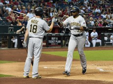 PHOENIX, AZ - APRIL 22: Gregory Polanco #25 of the Pittsburgh Pirates celebrates with teammate Jonathon Niese #49 after hitting a home run against the Arizona Diamondbacks during the second inning at Chase Field on April 22, 2016 in Phoenix, Arizona. (Photo by Norm Hall/Getty Images)