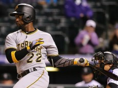 DENVER, CO - APRIL 26:  Andrew McCutchen #22 of the Pittsburgh Pirates grounds out to shortstop Cristhian Adames #18 of the Colorado Rockies in the eighth inning at Coors Field on April 26, 2016 in Denver, Colorado. The Pirates defeated Rockies 9-4.  (Photo by Doug Pensinger/Getty Images)