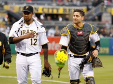 PITTSBURGH, PA - APRIL 29:  Juan Nicasio #12 and Francisco Cervelli #29 of the Pittsburgh Pirates walk to the dugout before the game against the Cincinnati Reds at PNC Park on April 29, 2016 in Pittsburgh, Pennsylvania.  (Photo by Justin K. Aller/Getty Images)