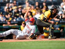 PITTSBURGH, PA - MAY 1:  Adam Duvall #23 of the Cincinnati Reds scores in front of Chris Stewart #19 of the Pittsburgh Pirates during the ninth inning on May 1, 2016 at PNC Park in Pittsburgh, Pennsylvania.  (Photo by Joe Sargent/Getty Images)