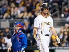 PITTSBURGH, PA - MAY 02:  John Jaso #28 of the Pittsburgh Pirates flips his bat as he walks back to the dugout after striking out in the seventh inning during the game against the Chicago Cubs at PNC Park on May 2, 2016 in Pittsburgh, Pennsylvania. (Photo by Justin Berl/Getty Images)