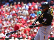 ST. LOUIS, MO - MAY 7: Gregory Polanco #25 of the Pittsburgh Pirates hits an RBI single against the St. Louis Cardinals in the first inning at Busch Stadium on May 7, 2016 in St. Louis, Missouri.  (Photo by Dilip Vishwanat/Getty Images)