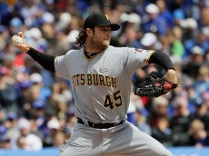 CHICAGO, IL - MAY 15:  Starting pitcher Gerrit Cole #45 of the Pittsburgh Pirates delivers the ball against the Chicago Cubs at Wrigley Field on May 15, 2016 in Chicago, Illinois.  (Photo by Jonathan Daniel/Getty Images)