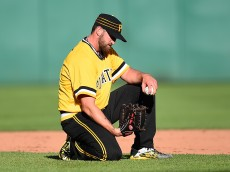 PITTSBURGH, PA - JUNE 12:  Jonathon Niese #18 of the Pittsburgh Pirates reacts after bobbling a ball hit by Jhonny Peralta #27 of the St. Louis Cardinals (not pictured) during the sixth inning on June 12, 2016 at PNC Park in Pittsburgh, Pennsylvania.  (Photo by Joe Sargent/Getty Images)