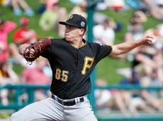 LAKE BUENA VISTA, FL - MARCH 5: Steven Brault #65 of the Pittsburgh Pirates pitches against the Atlanta Braves in the fifth inning of a spring training game at Champion Stadium on March 5, 2016 in Lake Buena Vista, Florida. The Pirates defeated the Braves 9-6. (Photo by Joe Robbins/Getty Images)