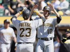 OAKLAND, CA - JULY 03:  David Freese #23 of the Pittsburgh Pirates is congratulated by Jordy Mercer #10 after he hit a two-run home run that scored them both in the eighth inning against the Oakland Athletics at the Coliseum on July 3, 2016 in Oakland, California.  (Photo by Ezra Shaw/Getty Images)