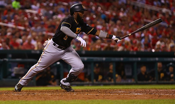ST. LOUIS, MO - JULY 6: Josh Harrison #5 of the Pittsburgh Pirates hits an RBI single against the St. Louis Cardinals in the sixth inning at Busch Stadium on July 6, 2016 in St. Louis, Missouri.  (Photo by Dilip Vishwanat/Getty Images)