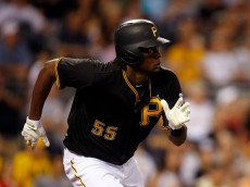 PITTSBURGH, PA - JULY 08: Josh Bell #55 of the Pittsburgh Pirates singles in the seventh inning for his first major league hit in the seventh inning during the game against the Chicago Cubs at PNC Park on July 8, 2016 in Pittsburgh, Pennsylvania. (Photo by Justin K. Aller/Getty Images)