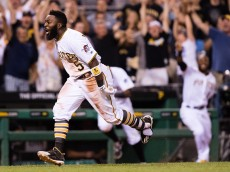 PITTSBURGH, PA - JULY 19:  Josh Harrison #5 of the Pittsburgh Pirates celebrates as he heads towards home plate after hitting a triple and comes in to score on a throwing error by Scooter Gennett #2 of the Milwaukee Brewers to give the Pittsburgh Pirates a 3-2 win over the Milwaukee Brewers at PNC Park on July 19, 2016 in Pittsburgh, Pennsylvania. (Photo by Justin Berl/Getty Images)