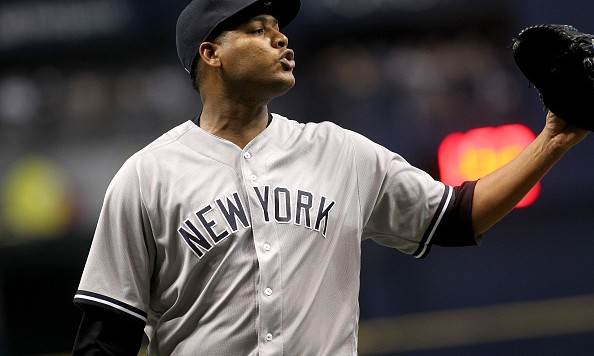 ST. PETERSBURG, FL - JULY 29: Pitcher Ivan Nova #47 of the New York Yankees argues with home plate umpire Laz Diaz after being taken off the mound by manager Joe Girardi during the fifth inning of a game on July 29, 2016 at Tropicana Field in St. Petersburg, Florida. (Photo by Brian Blanco/Getty Images)