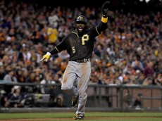 SAN FRANCISCO, CA - AUGUST 15:  Josh Harrison #5 of the Pittsburgh Pirates celebrates as he scores against the San Francisco Giants in the top of the seventh inning at AT&T Park on August 15, 2016 in San Francisco, California. The Pirates won the game 8-5.  (Photo by Thearon W. Henderson/Getty Images)