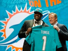 CHICAGO, IL - APRIL 28:  (L-R) Laremy Tunsil of Ole Miss holds up a jersey with NFL Commissioner Roger Goodell after being picked #13 overall by the Miami Dolphins during the first round of the 2016 NFL Draft at the Auditorium Theatre of Roosevelt University on April 28, 2016 in Chicago, Illinois.  (Photo by Jon Durr/Getty Images)