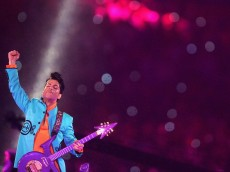 """MIAMI GARDENS, FL - FEBRUARY 04:  Musician Prince performs during the """"Pepsi Halftime Show"""" at Super Bowl XLI between the Indianapolis Colts and the Chicago Bears on February 4, 2007 at Dolphin Stadium in Miami Gardens, Florida.  (Photo by Jed Jacobsohn/Getty Images)"""