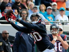 JACKSONVILLE, FL - OCTOBER 18:  DeAndre Hopkins #10 of the Houston Texans attempts a reception during the game against the Jacksonville Jaguars at EverBank Field on October 18, 2015 in Jacksonville, Florida.  (Photo by Sam Greenwood/Getty Images)