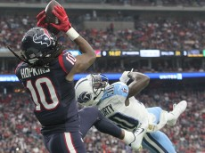 HOUSTON, TX - NOVEMBER 01: DeAndre Hopkins #10 of the Houston Texans makes a touchdown catch against Jason McCourty #30 of the Tennessee Titans in the second quarter on November 1, 2015 at NRG Stadium in Houston, Texas. (Photo by Thomas B. Shea/Getty Images)