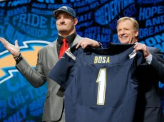 CHICAGO, IL - APRIL 28:  (L-R) Joey Bosa of Ohio State holds up a jersey with NFL Commissioner Roger Goodell after being picked #3 overall by the San Diego Chargers during the first round of the 2016 NFL Draft at the Auditorium Theatre of Roosevelt University on April 28, 2016 in Chicago, Illinois.  (Photo by Jon Durr/Getty Images)
