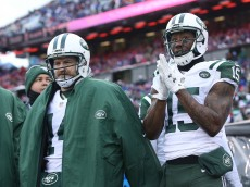 ORCHARD PARK, NY - JANUARY 03:   Ryan Fitzpatrick #14 of the New York Jets and Brandon Marshall #15 of the New York Jets watch the game against the Buffalo Bills from the sidelines during the first half at Ralph Wilson Stadium on January 3, 2016 in Orchard Park, New York.  (Photo by Tom Szczerbowski/Getty Images)