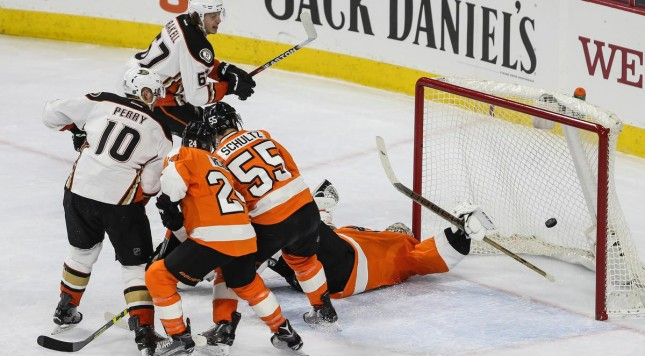 Philadelphia Flyers goalie Steve Mason, right, can't stop a power play goal by the Anaheim Ducks' Rickard Rakell, top, during the first period at the Wells Fargo Center in Philadelphia on Tuesday, Feb. 9, 2016. (Steven M. Falk/Philadelphia Inquirer/TNS)