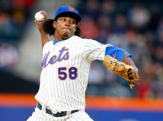NEW YORK, NY - APRIL 26:  Jenrry Mejia #58 of the New York Mets pitches in the first inning against the Miami Marlins at Citi Field on April 26, 2014 in the Flushing neighborhood of the Queens borough of New York City.  (Photo by Mike Stobe/Getty Images)