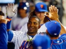 NEW YORK, NY - JUNE 30:  Yoenis Cespedes #52 of the New York Mets celebrates his sixth inning home run against the Chicago Cubs in the dugout with his teammates at Citi Field on June 30, 2016 in the Flushing neighborhood of the Queens borough of New York City.  (Photo by Jim McIsaac/Getty Images)