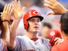 MIAMI, FL - JULY 09: Jay Bruce #32 of the Cincinnati Reds  high fives teammates after scoring a run during the fourth inning of the game against the Miami Marlins at Marlins Park on July 9, 2016 in Miami, Florida. (Photo by Rob Foldy/Getty Images)
