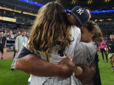 NEW YORK, NY - AUGUST 12: Alex Rodriguez #13 of the New York Yankees hugs his daughter Natasha and Ella after the game against the Tampa Bay Rays at Yankee Stadium on August 12, 2016 in New York City. (Photo by Drew Hallowell/Getty Images)