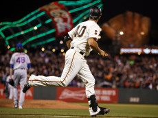 Madison Bumgarner of the San Francisco Giants rounds the bases after hitting a two-run home run off of Jacob deGrom. (Jason O. Watson/Getty Images)