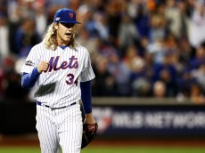NEW YORK, NY - OCTOBER 05:  Noah Syndergaard #34 of the New York Mets reacts during their National League Wild Card game against the San Francisco Giants at Citi Field on October 5, 2016 in New York City.  (Photo by Elsa/Getty Images)