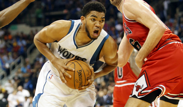 Oct 10, 2015; Winnipeg, Manitoba, CAN; Minnesota Timberwolves center Karl-Anthony Towns (32) drives to the basket Chicago Bulls forward Pau Gasol (16) during the second quarter at MTS Center. Mandatory Credit: Bruce Fedyck-USA TODAY Sports
