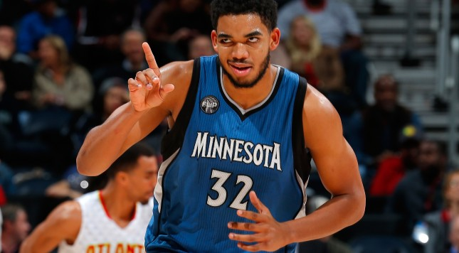 ATLANTA, GA - NOVEMBER 09:  Karl-Anthony Towns #32 of the Minnesota Timberwolves reacts after hitting a basket against the Atlanta Hawks at Philips Arena on November 9, 2015 in Atlanta, Georgia.  NOTE TO USER User expressly acknowledges and agrees that, by downloading and or using this photograph, user is consenting to the terms and conditions of the Getty Images License Agreement.  (Photo by Kevin C. Cox/Getty Images)