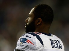 FOXBORO, MA - AUGUST 15: Darrelle Revis #24 of the New England Patriots watches the action from the sideline during a pre-season game with the Philadelphia Eagles at Gillette Stadium on August 15, 2014 in Foxboro, Massachusetts. (Photo by Jim Rogash/Getty Images)