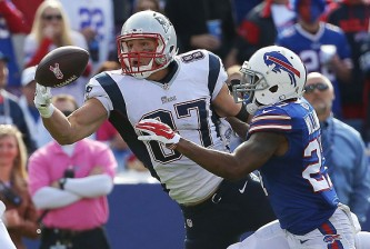 ORCHARD PARK, NY - OCTOBER 12:   Rob Gronkowski #87 of the New England Patriots makes a catch in front of  Duke Williams #27 of the Buffalo Bills during the second half at Ralph Wilson Stadium on October 12, 2014 in Orchard Park, New York.  (Photo by Tom Szczerbowski/Getty Images)