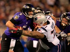 BALTIMORE, MD - DECEMBER 22: Defensive tackle Sealver Siliga #71 of the New England Patriots sacks quarterback Joe Flacco #5 of the Baltimore Ravens during the second half of the Patriots 41-7 win at M&T Bank Stadium on December 22, 2013 in Baltimore, Maryland.  (Photo by Rob Carr/Getty Images)