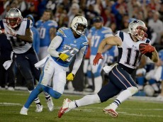 SAN DIEGO, CA-  DECEMBER 7:  Julian Edelman #11 of the New England Patriots runs for a touchdown against Shareece Wright #29 of the San Diego Chargers during an NFL game at Qualcomm Stadium on December 7, 2014 in San Diego, California. (Photo by Donald Miralle/Getty Images)