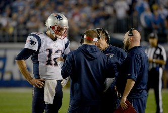 SAN DIEGO, CA-  DECEMBER 7:  Tom Brady #12 of the New England Patriots speaks with head coach Bill Belichick and offensive coordinator Josh McDaniels en route to the Patriots' 23-14 win over the San Diego Chargers during an NFL game at Qualcomm Stadium on December 7, 2014 in San Diego, California. (Photo by Donald Miralle/Getty Images)
