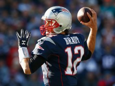FOXBORO, MA - DECEMBER 14:  Tom Brady #12 of the New England Patriots passes the ball during the first quarter against the Miami Dolphins at Gillette Stadium on December 14, 2014 in Foxboro, Massachusetts.  (Photo by Jared Wickerham/Getty Images)